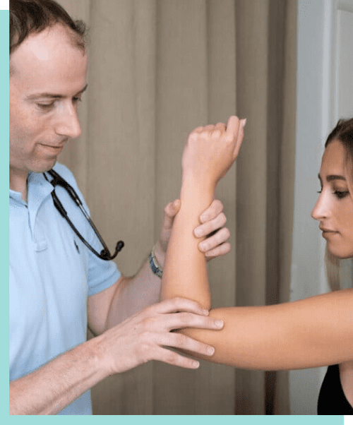doctor checking a patients arm