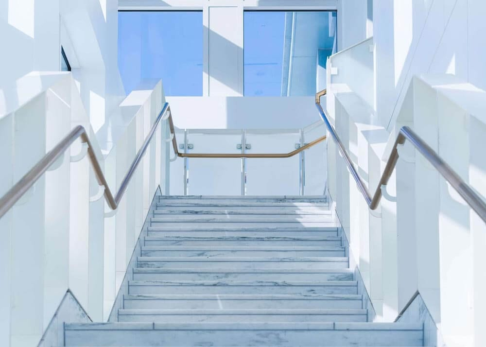 white staircase leading up